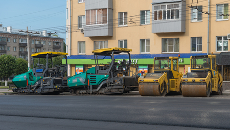 construction vibroroller: July 30, 2016. Photo of road construction equipment outside of the city of Cheboksary. Laying asphalt road. Cheboksary. Russia.