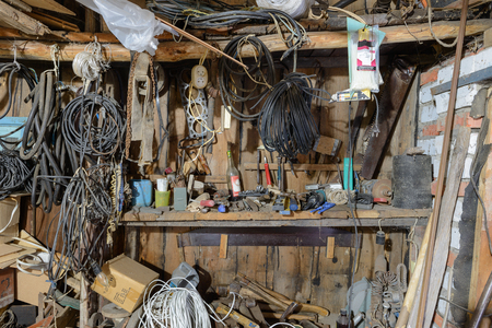 pile of tools and various items in the workshop
