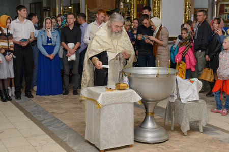 baptizing: August 12, 2015: Photo of baptized in the Orthodox Church. Cheboksary. Russia Editorial