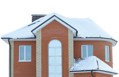 isolated brick apartment house with a snow-covered roof Stock Photo