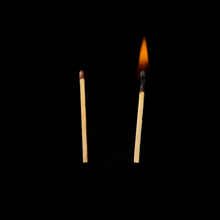 two matches. burning one and one is not burning