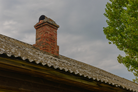 old brick roof pipe made of slate