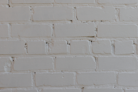 rows of brick wall painted white paint