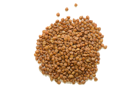heap of buckwheat porridge on a white background