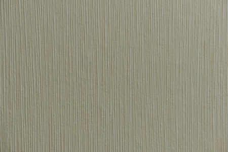 dark beige surface with embossed vertical stripes