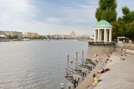 August 12, 2013: People sunbathe on the banks of the Moscow River. Gorky Park. Moscow. Russia.