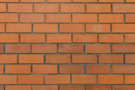wall structure with rows of red brick masonry