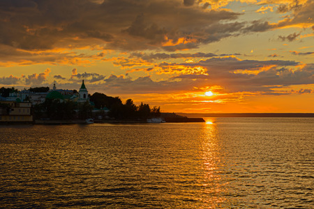July 5, 2014: Sunset sun on the embankment of the Volga River near the city of Cheboksary. Cheboksary. Russia.