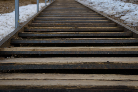old metal staircase with wooden steps to the hill Zdjęcie Seryjne