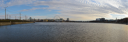 April 14, 2019: Panorama of Cheboksary Bay with buildings and monuments on a spring evening. Cheboksary. Russia. Publikacyjne