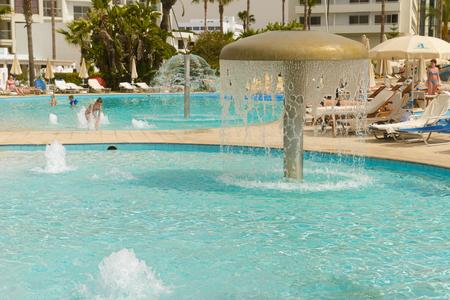 May 3, 2014: People bathe in the pools of the Adams Beach Hotel. Ayia Napa. Cyprus. Publikacyjne