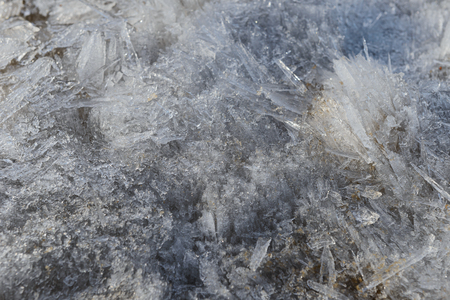 Melting of coaceously located ice crystals of various shapes on a spring day
