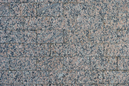 Surface of rectangular polished pieces of red and blue granite