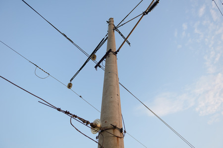 Concrete round pole with mounted electrical equipment