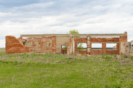 old destroyed brick walls of abandoned buildings on a cloudy spring day