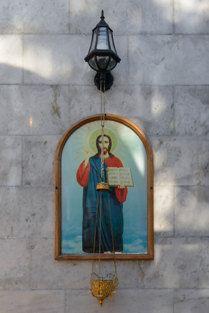 Orthodox icon and censer on the marble wall