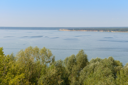 Summer landscape overlooking the wide river from a height
