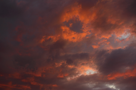 Dramatic sky with dark, red clouds at sunset Zdjęcie Seryjne