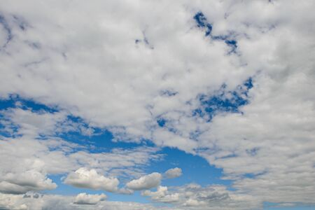 Expressive blue sky landscape with white clouds