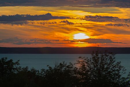 Landscape with a sunset over a wide river Zdjęcie Seryjne