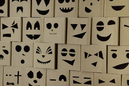 wall of square cardboard boxes with cut out faces