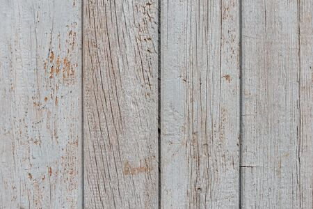 Old wooden vertical boards with peeled gray paint Zdjęcie Seryjne