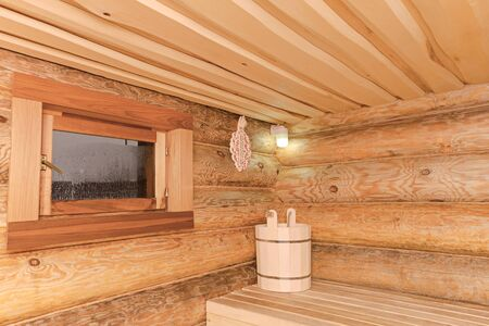 The interior of a wooden bathhouse from a log house