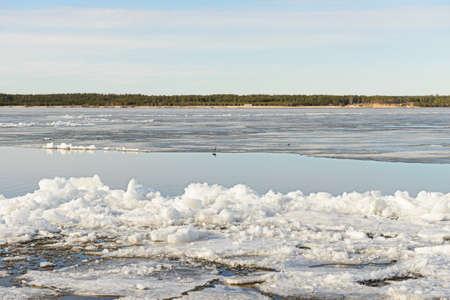 Spring landscape with melting ice on the river Banco de Imagens