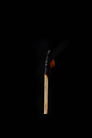 One burning match on a completely black background Banco de Imagens - 142743911