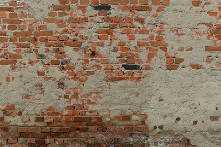 Full old cracked brick wall surface with cracks in full screen