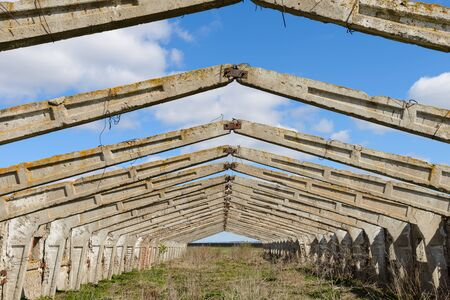 Ruins and frame of an old concrete structure on a sunny day Banco de Imagens