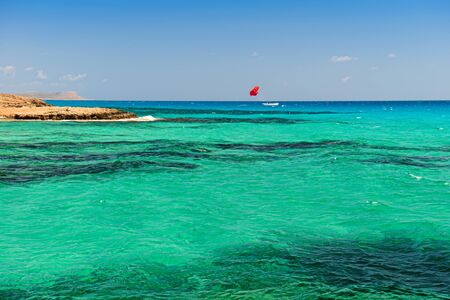 Mediterranean coast with a rocky coast and turquoise sea and white boat Banco de Imagens