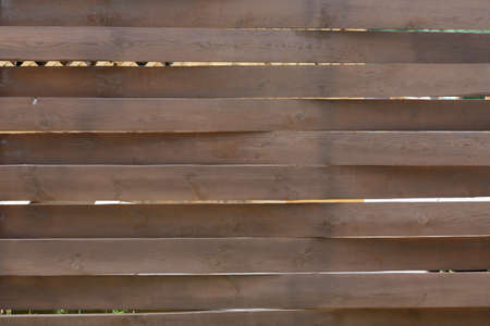 Wooden fence made of horizontal brown boards 版權商用圖片