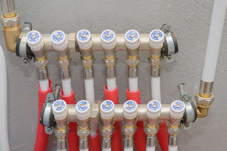 Many heating pipes connected to the collector on the wall