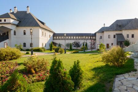 August 23, 2020: Beautiful green courtyard of an old monastery. Sviyazhsk. Russia.