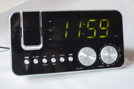 Electronic clock radio shows me 11:59 免版税图像