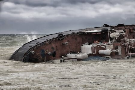 Sinking stern of a shipwrecked ship during a storm.