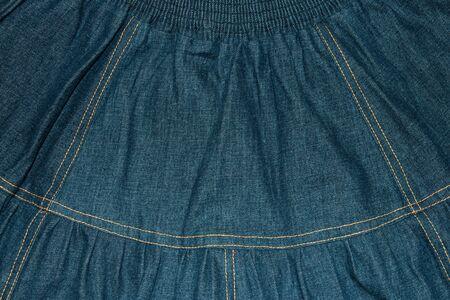Background, texture of a retro denim skirt.