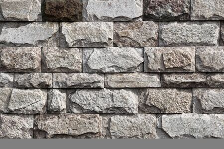 Background, texture gray wall made of natural stone.