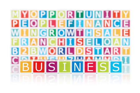 short phrase:  Business  concept with color alphabetic blocks isolated on white Stock Photo