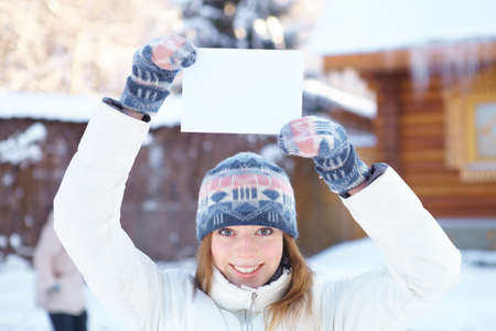 Young beautiful woman with blank banner  Winter