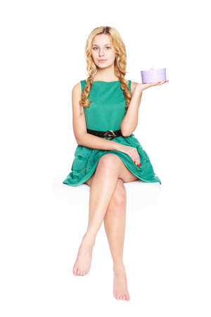 Beautiful blonde young woman with gift box