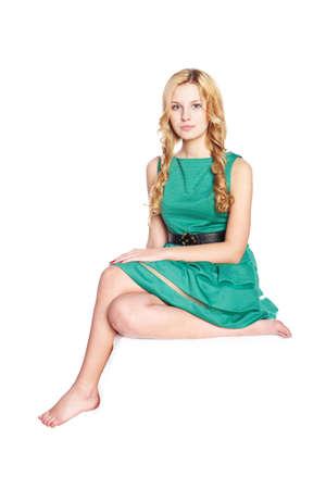 Beautiful blonde young woman sitting  Studio shot  Stock Photo