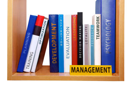Bookshelf with management knowledge and skills  Imagens