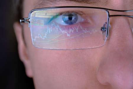financier: Financier in glasses looking at monitor  Stock Photo
