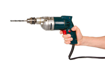 taladro: Mano con un taladro eléctrico. Foto de archivo
