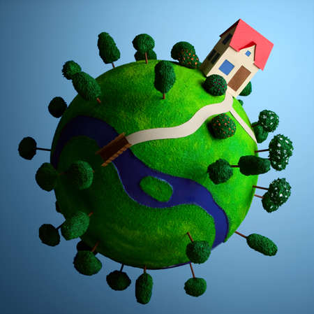 planetoid: Little green planet with toy house  Stock Photo