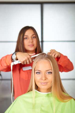 straightener: Hair salon  Women s haircut  Use of straightener