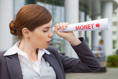 Businesswoman looks for money. photo