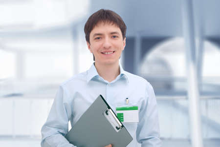 Office worker with document folder. photo